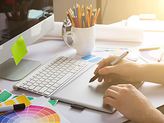 Web Designer Using Graphics Tablet